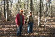 Forester Larry Powell and a forest owner discussing a PA forest stewardship plan
